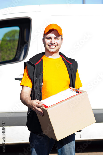 Delivery boy holding a box