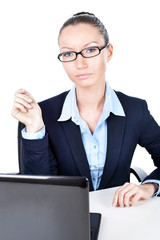 Business woman sitting with laptop in office