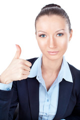 Businesswoman gesturing with a thumbs up