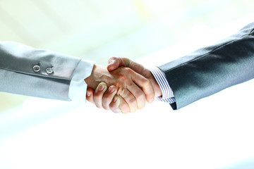Handshake businessmen in the office.