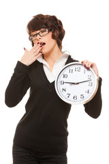 studio portrait of tired woman with clock