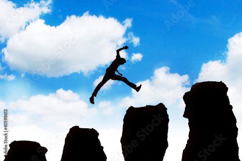 Man jumping off obstacles to the top