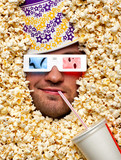 Face in popcorn watching 3D movie