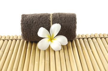 frangipani with roller towels on mat