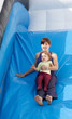 mother with  toddler on slide