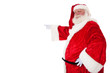 Weihnachtsmann zeigt mit dem Finger