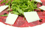 Beef carpaccio with parmesan and rocket