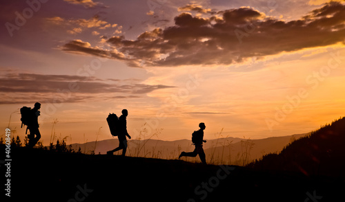 hikers on sunset