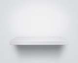 Empty white wooden shelf at the wall
