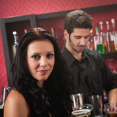 Attractive woman drink at cocktail bar