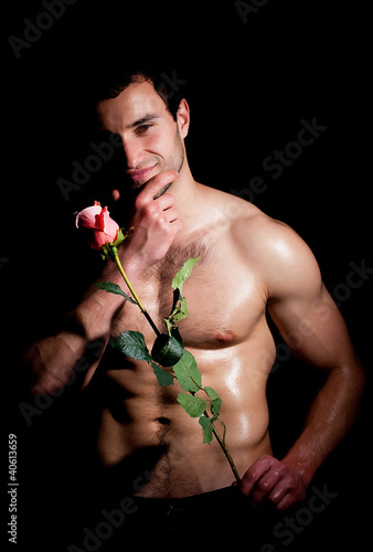 Valentines man in a fashion pose with rose
