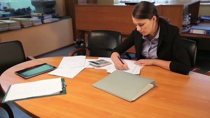 Attractive young woman working in office
