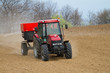 an agricultural tractor starts a chemical treatment