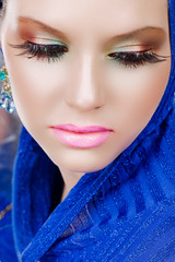 woman with long eyelashes in blue