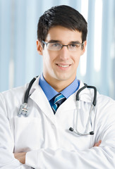 Portrait of happy doctor at office