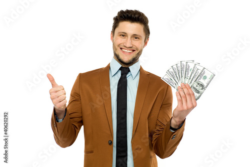 Man with dollar bills showing thumbs up