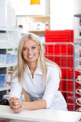 Smiling Female Chemist at Counter