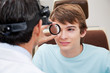Optometrist performing Dilated Retinal Exam