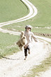 Girl with teddy is running