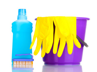 Detergent and bucket with gloves isolated on white