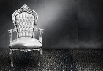 A vintage chair on metal background