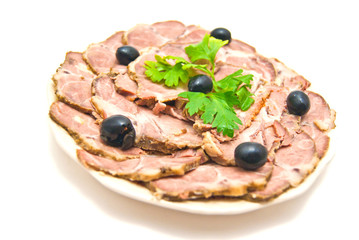 meat with herbs on a plate on white