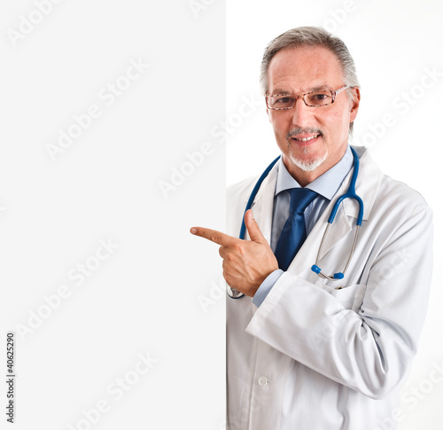 Doctor pointing a white board