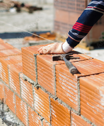 Placing bricks on bricklayer