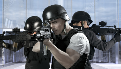 Police against terrorism, two soldiers at a business building