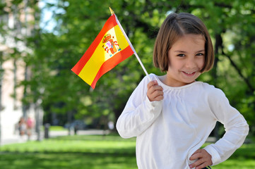 A Young Girl Holding Spanish Flag