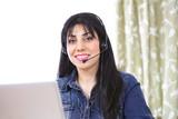 Pretty woman using Internet telephony