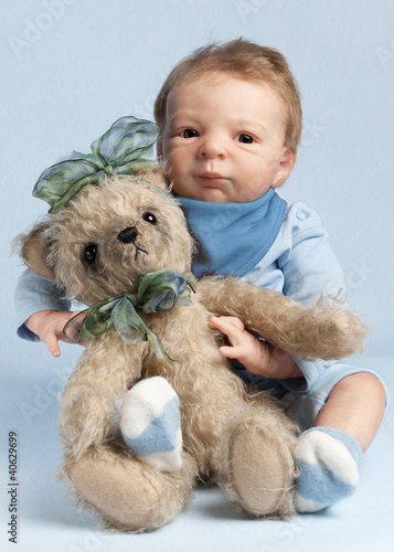 Adorable baby with teddy bear