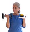 Surprised Woman Holding Dumbbell and Cupcake