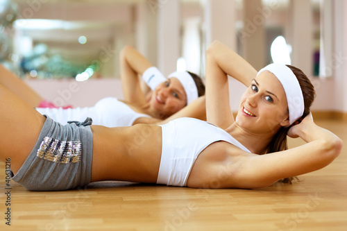 Woman in sport wear doing sport in gym