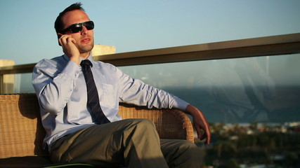 Businessman on the phone, outdoors