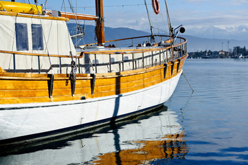 Colorful closeup picture of vintage sailing vessel at anchor