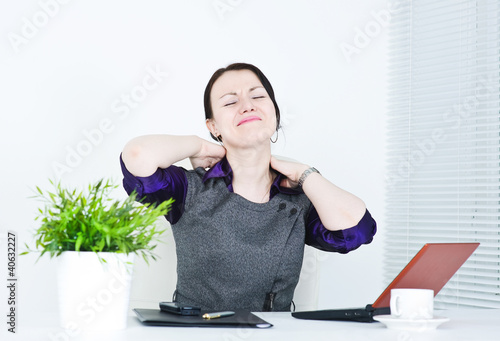 Business woman with pain in her neck