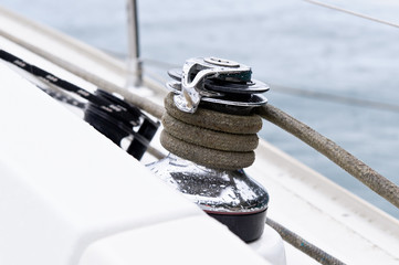 Sailing boat winch with mooring line attached