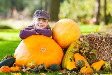 girl with huge pumpkin