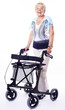 happy senior lady with walker for disabled people