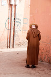 man standing in authentic Moroccan back street poster