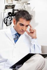 Serious Optometrist At Work