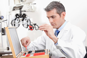 Optometrist Holding Measuring Eye Glasses