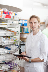 Portrait Of Male Pharmacist Holding Tablet Pc