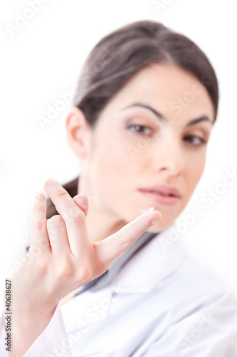 Optometrist Holding Contact Lens