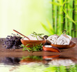 Spa still life with bamboo background and water surface