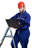 man with laptop in workwear poster
