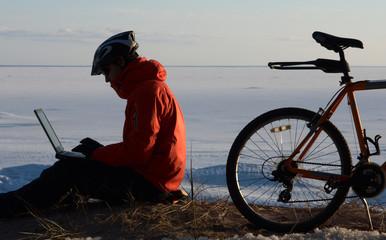 Freelancer at work against frozen sea