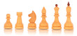 Chess. a group of white wooden chess pieces