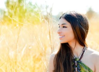 Asian indian woman profile portrait in golden field